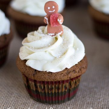 gingerbread cupcakes with white chocolate frosting and a gingerbread topper