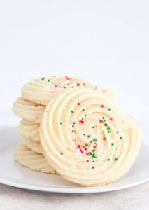 Spritz Cookies - festive swirled cookies full of almond flavor and piped with a star tip.