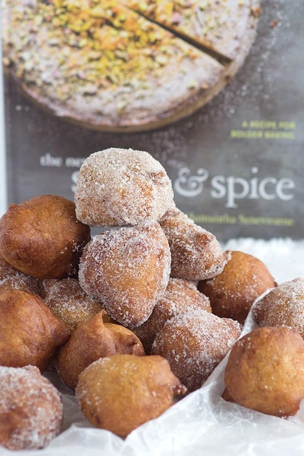 A pile of sweet banana fritters with nutmeg sugar coating