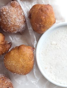 Banana fritters dusted with powdered sugar