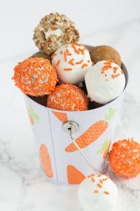 cream cheese carrot cake cake pops in a bucket decorated for Easter