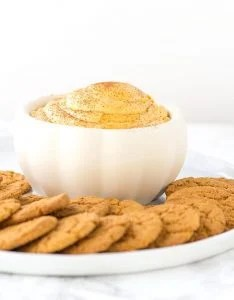 Pumpkin Pie Dip - fluffy dip loaded with pumpkin, spice, and everything nice. It tastes like a mouth full of pumpkin pie and goes perfectly with gingersnaps or graham crackers.