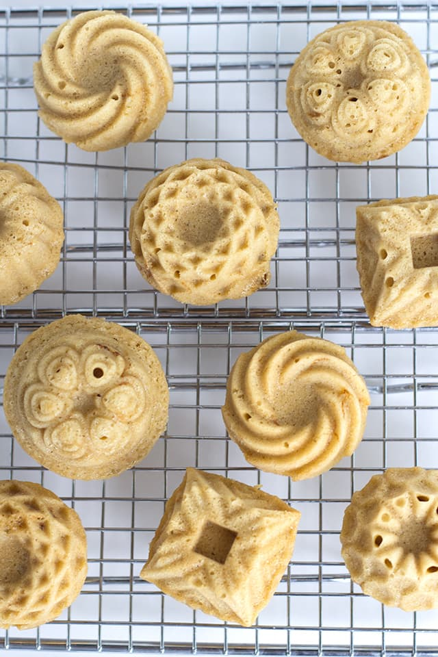 Mini Coffee and Cream Cakes - Moist little coffee flavored cakes with a vanilla butter glaze poured over top.