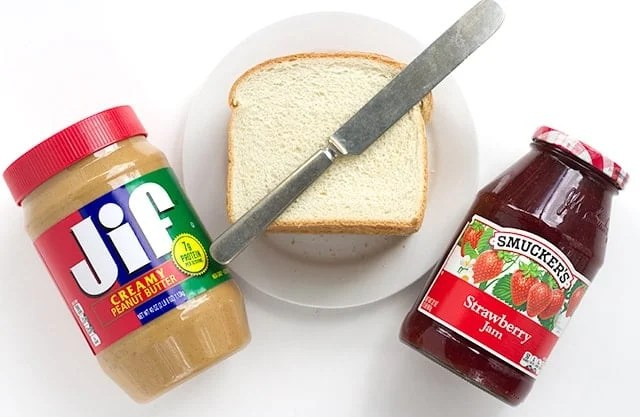 Ingredients needed for toasted peanut butter and jelly sandwich