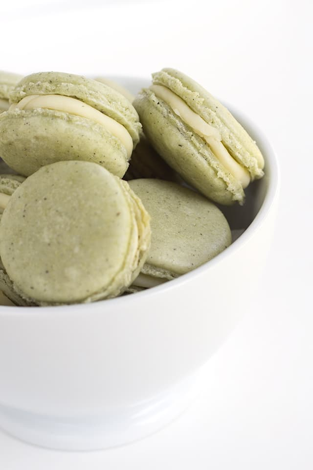 green tea french macarons in a white bowl