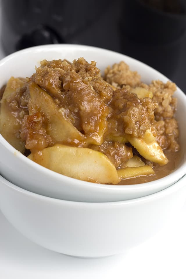 close up of the crisp topping on the slow cooker peanut butter apple crisp in white bowl