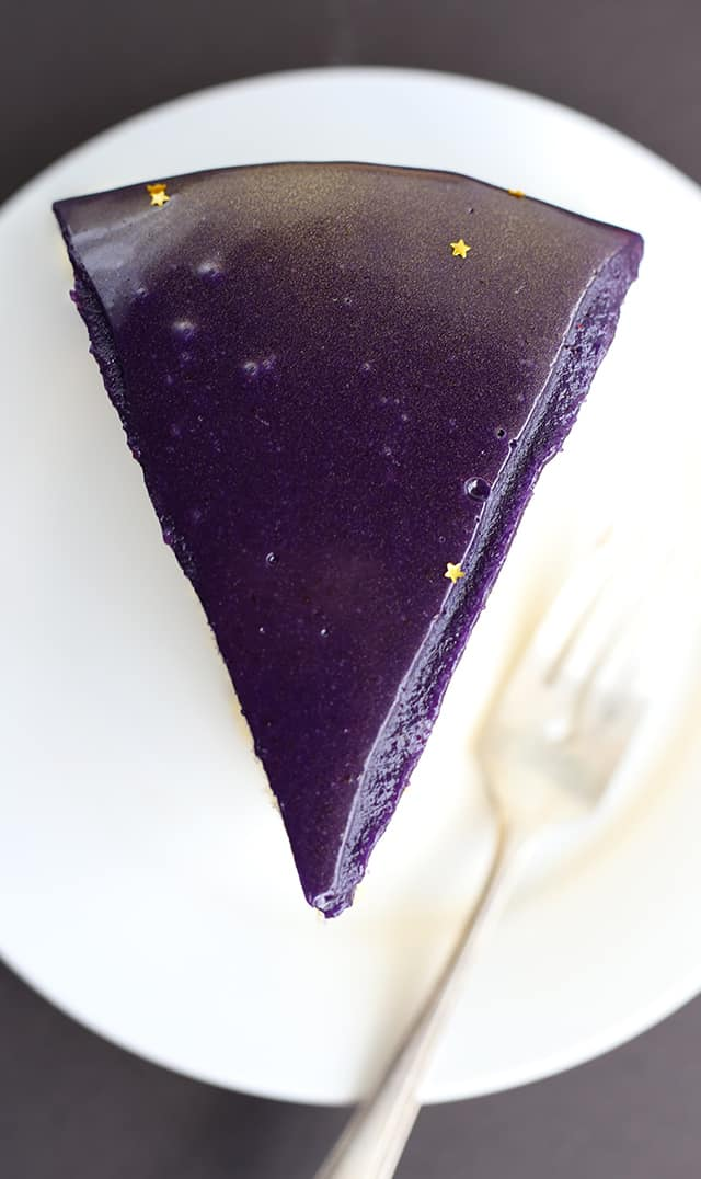 beautiful slice of violet colored Jell-o Mirror Glaze Cake