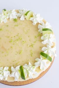 Close up overhead key lime cheesecake with white background