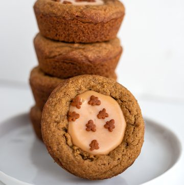 stack of fudge filled gingerbread cookie cups with a cookie cup leaned against stack on a white plate