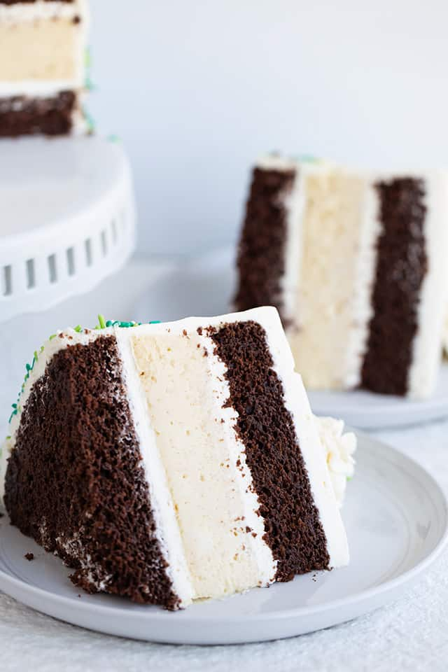 slice of Guinness and Baileys Cheesecake Cake on a white dessert plate