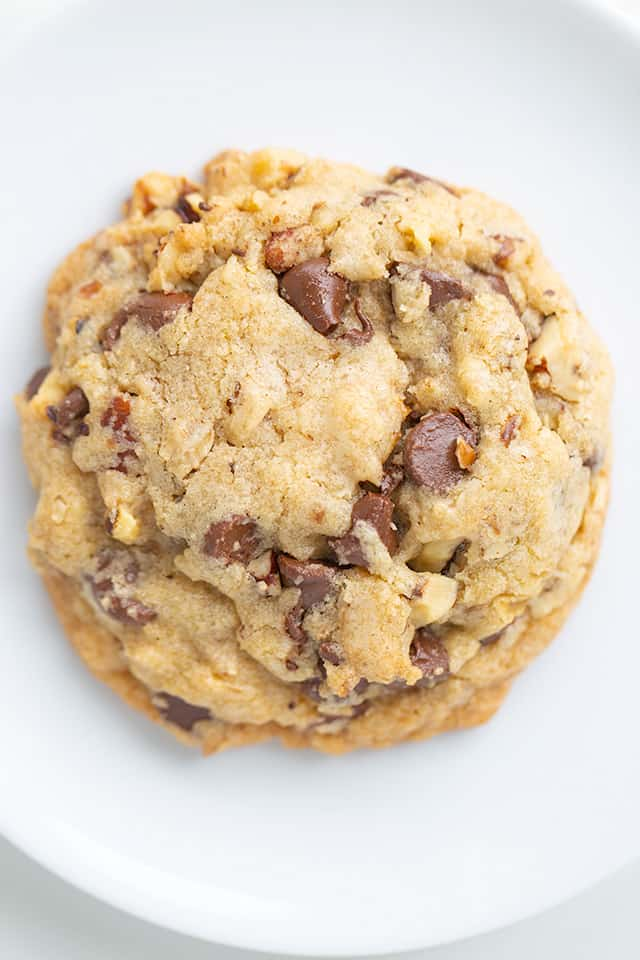 overhead close up photo of a doubletree chocolate chip cookie on a white background