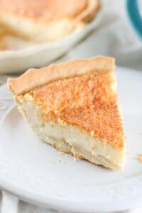 slice of sugar cream pie on whole pie behind it
