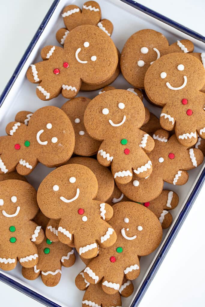 gingerbread cookies stacked in a white pan