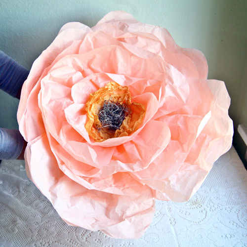 diy project  giant paper flowers from ruche     Design Sponge Attach the center to the petals  and the flower is complete