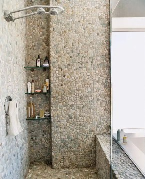 41 Cool And Eye Catchy Bathroom Shower Tile Ideas   DigsDigs pebble and river rocks tiles