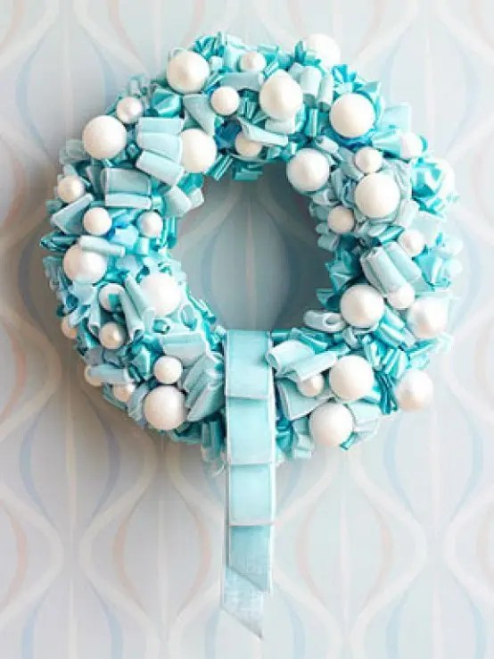 75 Awesome Christmas Wreaths Ideas For All Types Of D    cor   DigsDigs Adding snowballs to ribbon wreath is a great way to add winter touch to its  decor