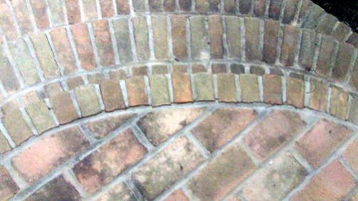 Repair Crumbling Mortar In Round Brick Stairwell To Front