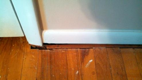 How to handle gaps between floor and wall trim    DoItYourself com     How to handle gaps between floor and wall trim