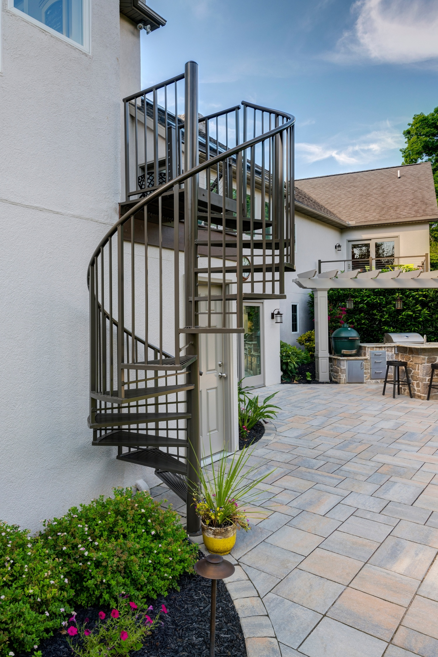 Adding A Patio Under Your Deck Tips And Ideas For Homeowners In   Spiral Stairs Off Deck   Railing   Wood Deck   Metal   Stair Case   Stairway