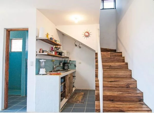Kitchen Under Stairs Inspiration — Eatwell101 | Small Kitchen Design Under Stairs | Stair Storage | Dining Room | Basement Kitchenette | Space Saving | Small Spaces