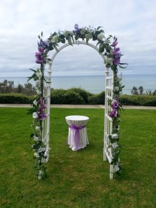 Wedding Arch Decorations White arch shown in photo above with silk white flower garland all around  and red roses  Other color roses and garland available  Photo taken at  Pines Park