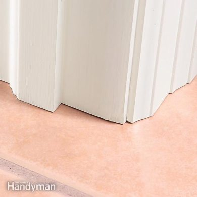Entryway Floor Tile Installation   The Family Handyman Slide tile under trim for the best appearance