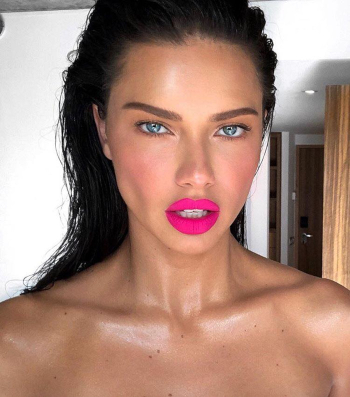 The Hottest Summer Lip Colors Spotted on Celebs Adriana Lima neon pink lipstick