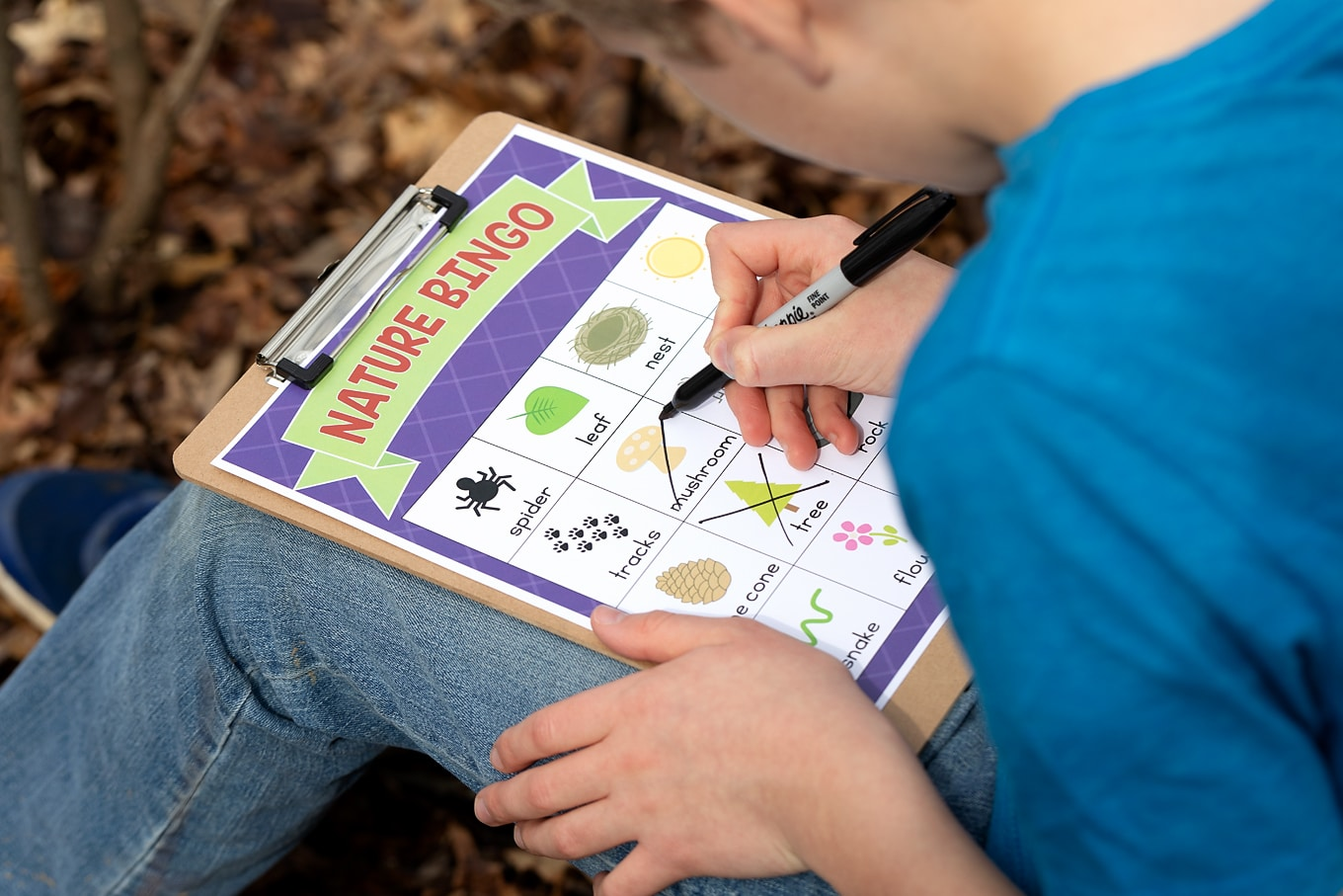Child Playing Nature Scavenger Hunt