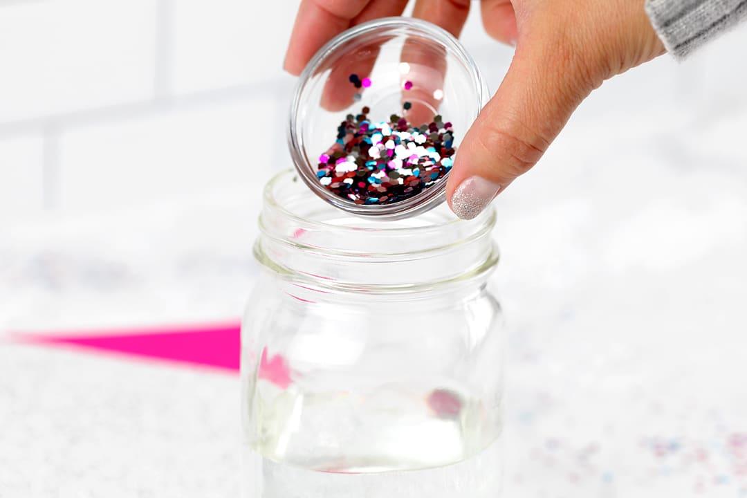 Sprinkling Glitter Into a Glitter Jar