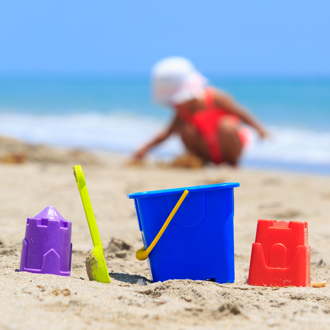 Child on Beach with Sand Toys