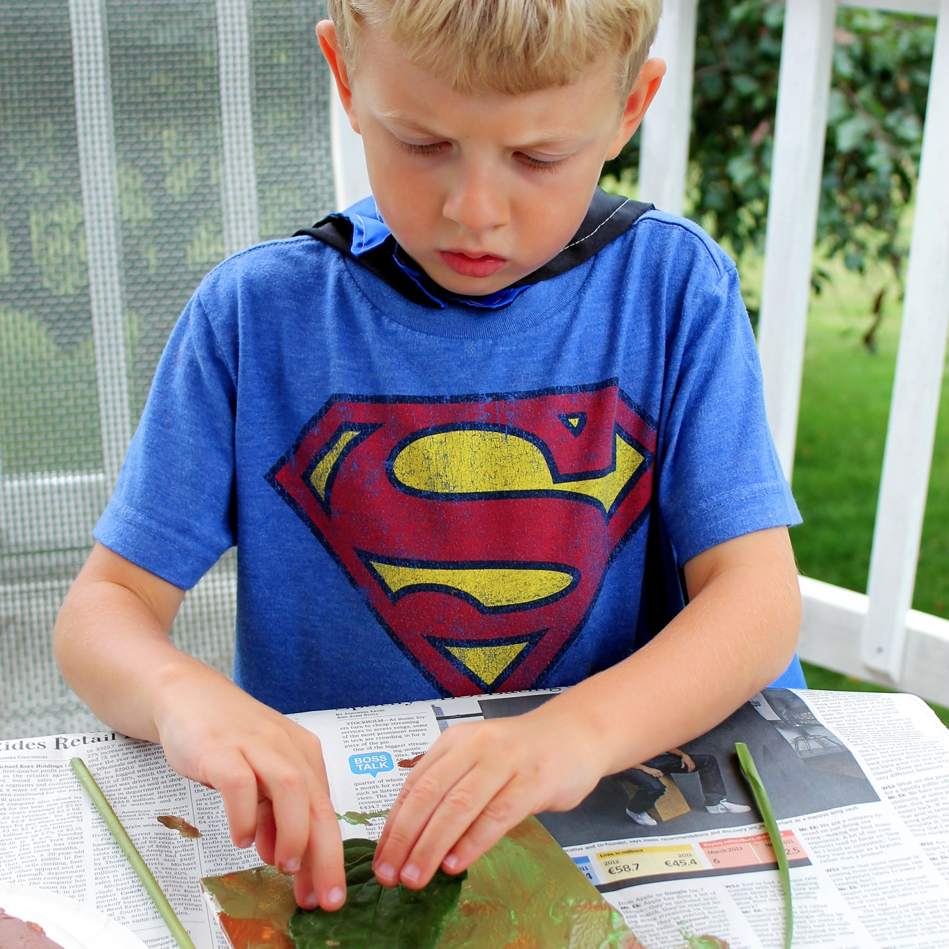 Child Painting with Natural Materials
