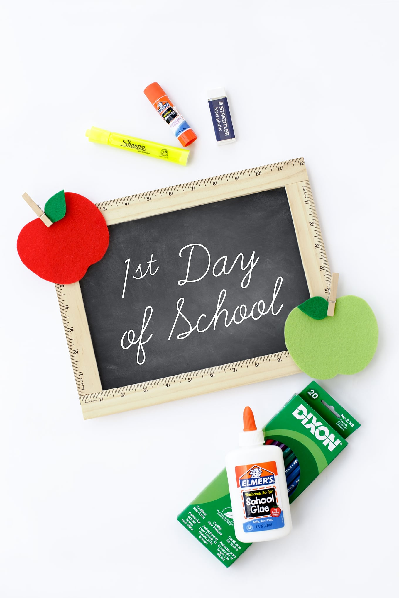 Learn how to make an easy DIY First Day of School Sign. It's the perfect back to school photo prop for kids!