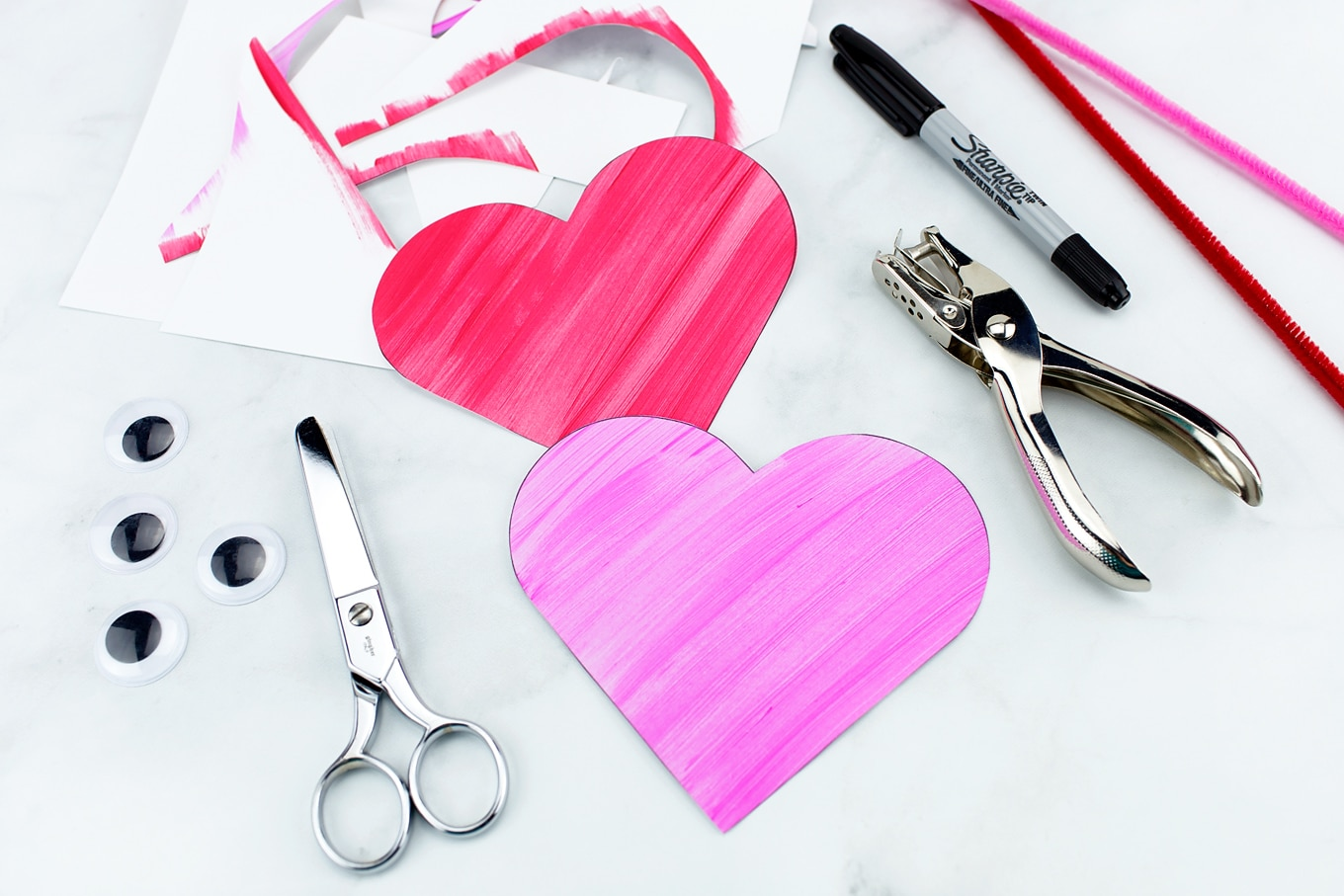 Cutting Out Heart Buddies Easy Valentine's Day Craft for Kids