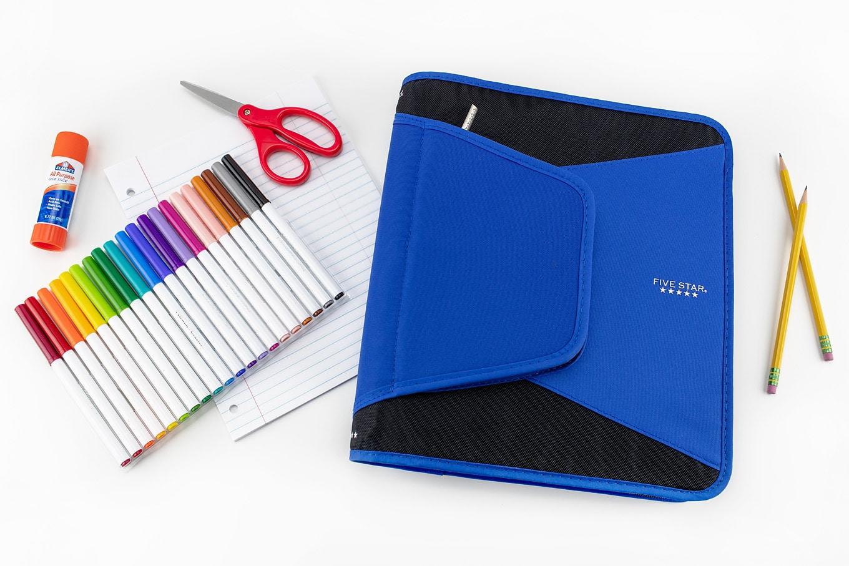 School Supplies and Homework Binder on a White Desk