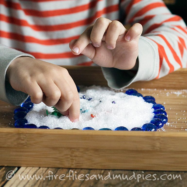 Creative play in a salt tray | Fireflies and Mud Pies