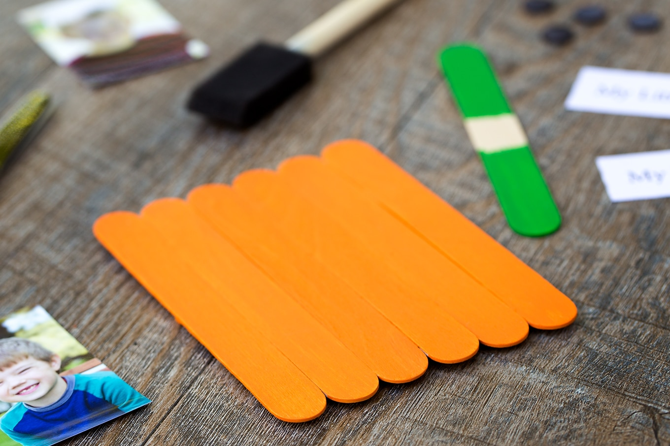 Painting the popsicle stick pumpkin craft