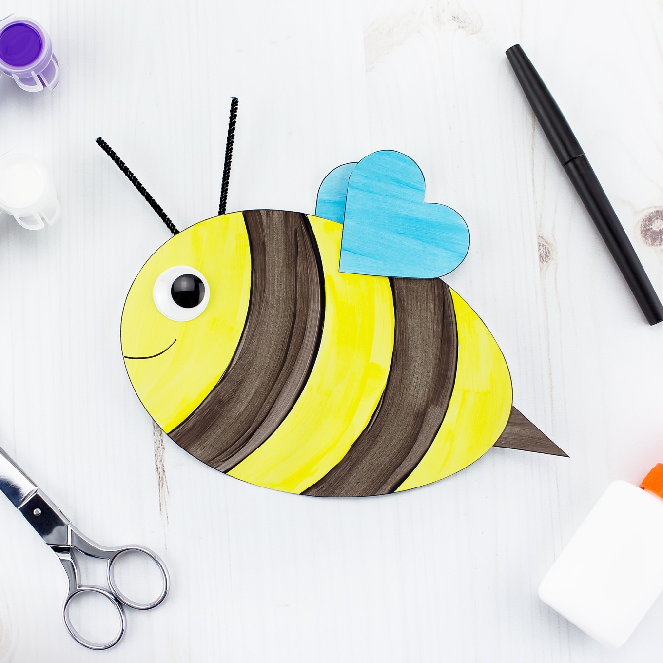 Easy and Fun Bee Craft for Kids with Blue Heart-Shaped Wings