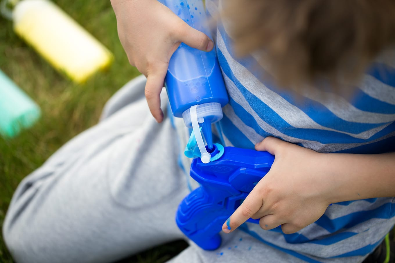 Boy Preparing Squirt Gun Tie-Dye