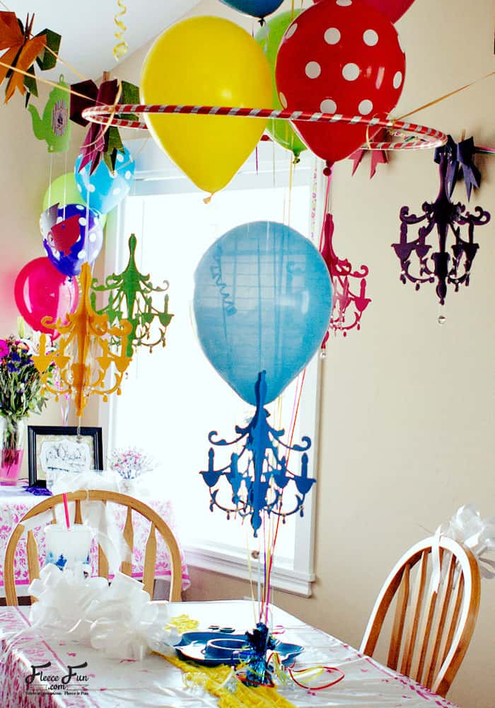 Learn how to make a paper chandelier with this easy step by step tutorial. I love this party decor idea. It looks very inexpensive to make too. Perfect for DIY party decorations.