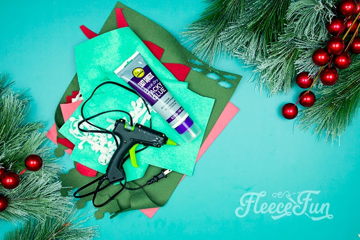 Items needed. This Felt Stocking Ornament  DIY with FREE template can be sued so any ways! Hand it on the tree, string it from garland or use it to hold a gift card!  The best part about this Christmas tree ornament is that it is No Sew