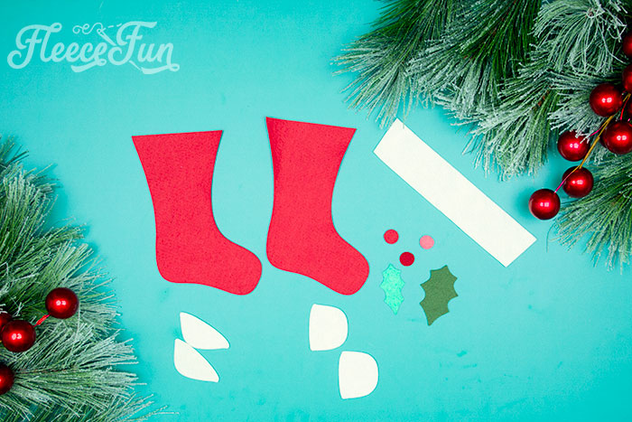 Items cut out. This Felt Stocking Ornament  DIY with FREE template can be sued so any ways! Hand it on the tree, string it from garland or use it to hold a gift card!  The best part about this Christmas tree ornament is that it is No Sew