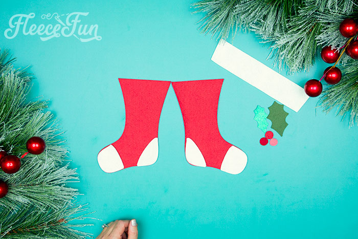 Glueing heels and toes to stocking. This Felt Stocking Ornament  DIY with FREE template can be sued so any ways! Hand it on the tree, string it from garland or use it to hold a gift card!  The best part about this Christmas tree ornament is that it is No Sew