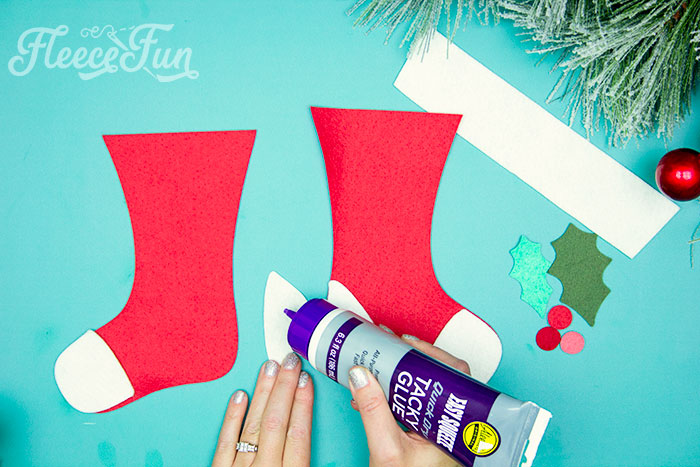 gluing continued. This Felt Stocking Ornament  DIY with FREE template can be sued so any ways! Hand it on the tree, string it from garland or use it to hold a gift card!  The best part about this Christmas tree ornament is that it is No Sew