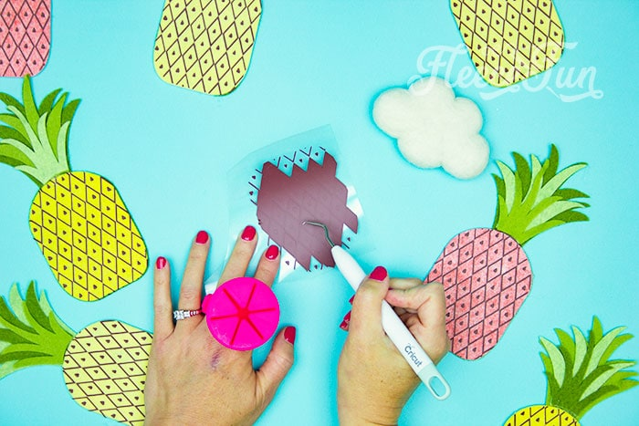 weeding HTV This DIY Pineapple décor is easy to make and has many possibilities! Use the free files to make anything from a cute shirt using HTV to a pillow using fabric. There is something magical about pineapples. They brings feeling of warmth, vacation and fun!