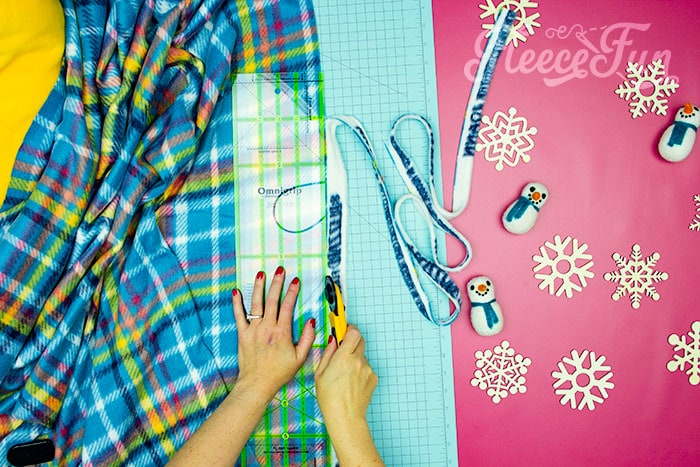 Cutting off selvege. Learn how to make a No Sew Fleece Tie Blanket 3 different ways. Never before seen techniques and FREE templates to make it fast and easy.