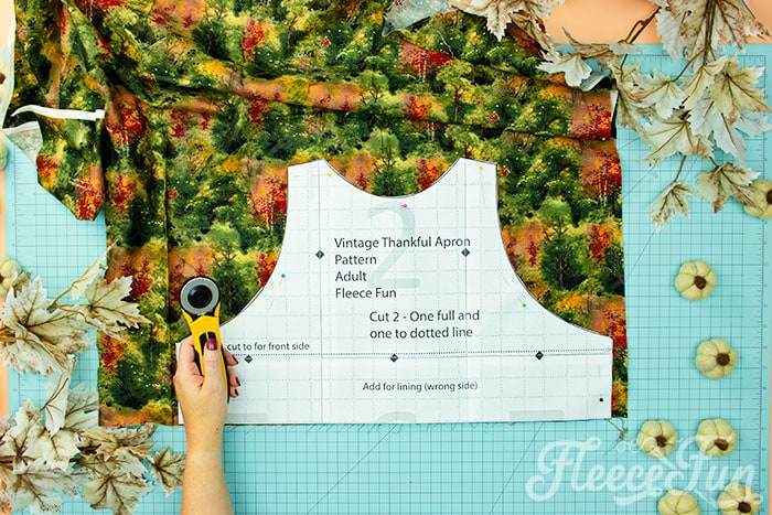 Bodice of apron being cut out. This Free apron pattern and tutorial includes a pdf pattern and video! Make a vintage style apron that is chic.