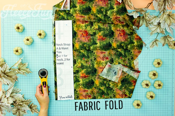 Neck strap placed on fold for cutting out. This Free apron pattern and tutorial includes a pdf pattern and video! Make a vintage style apron that is chic.