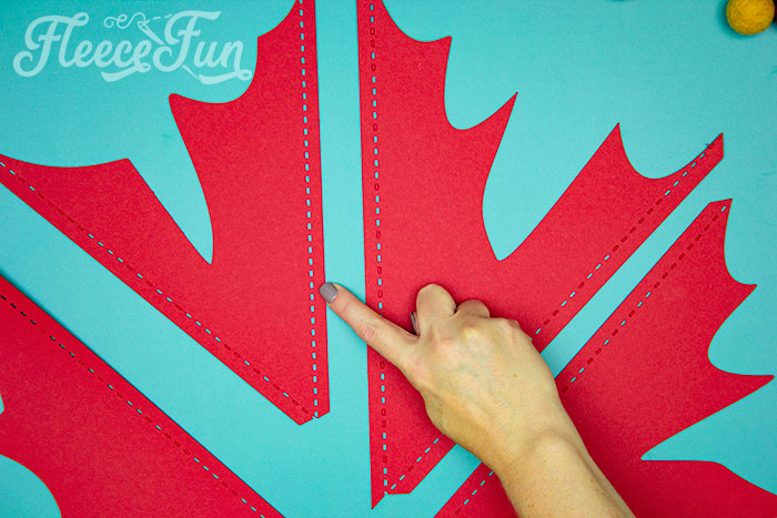 pointing to the dahsed score line. This Giant Maple Leaf Template and Tutorial (Free PDF and SVG) is larger than life. This step by step tutorial shows how to bring fall foliage indoors.