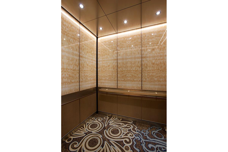 Better than Stone  ViviStone is a Lighter  Brighter Idea for the     LEVELe 105 Elevator Interior with upper panels in ViviStone Honey Onyx