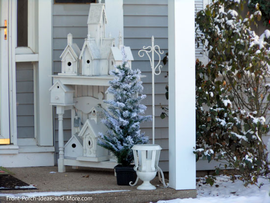 Winter Decorating Ideas for Your Porch   Decorating Ideas for Winter Winter beauty   snowy porch decorated with a vignette of birdhouses